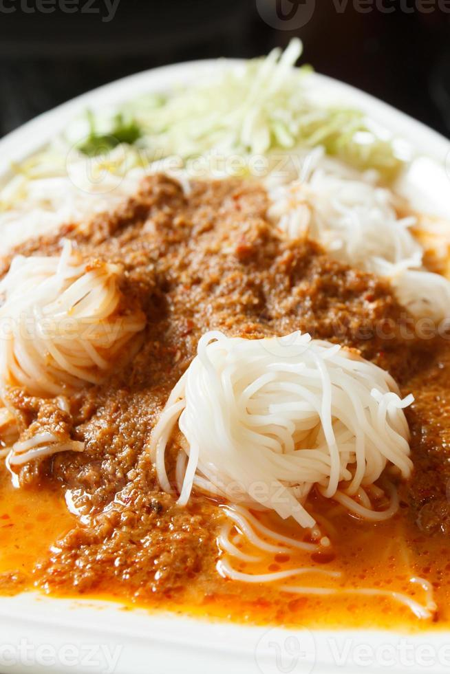 Rice noodles in fish curry sauce photo