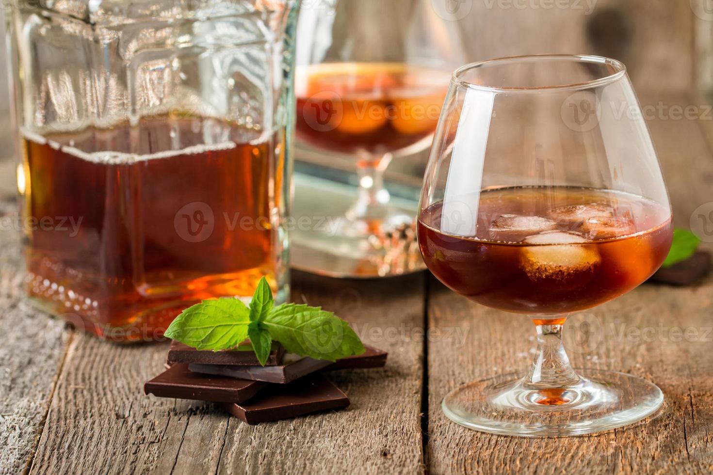 Vintage cognac still life with chocolate photo