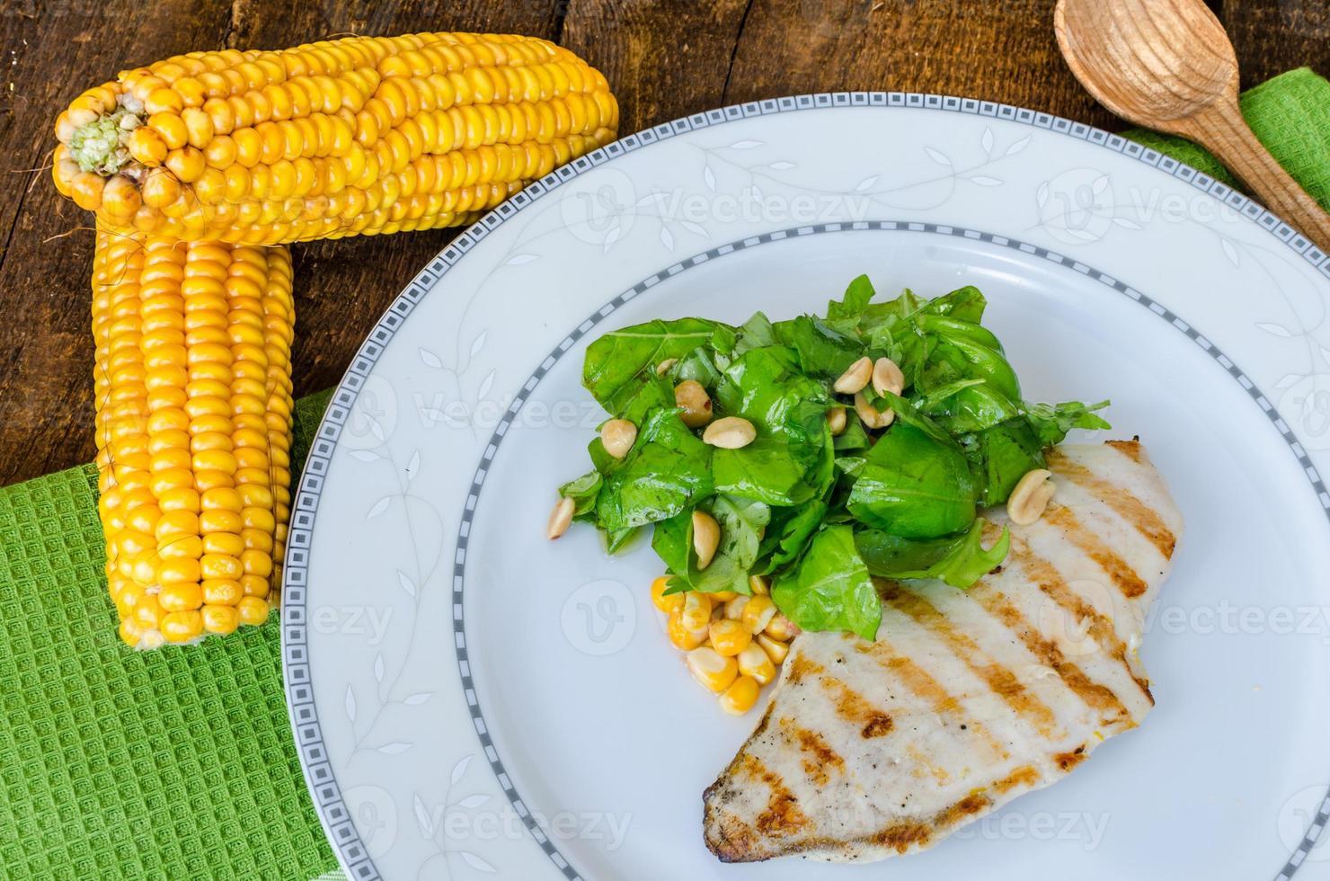 Chicken steak with garlic and lemon, salad photo