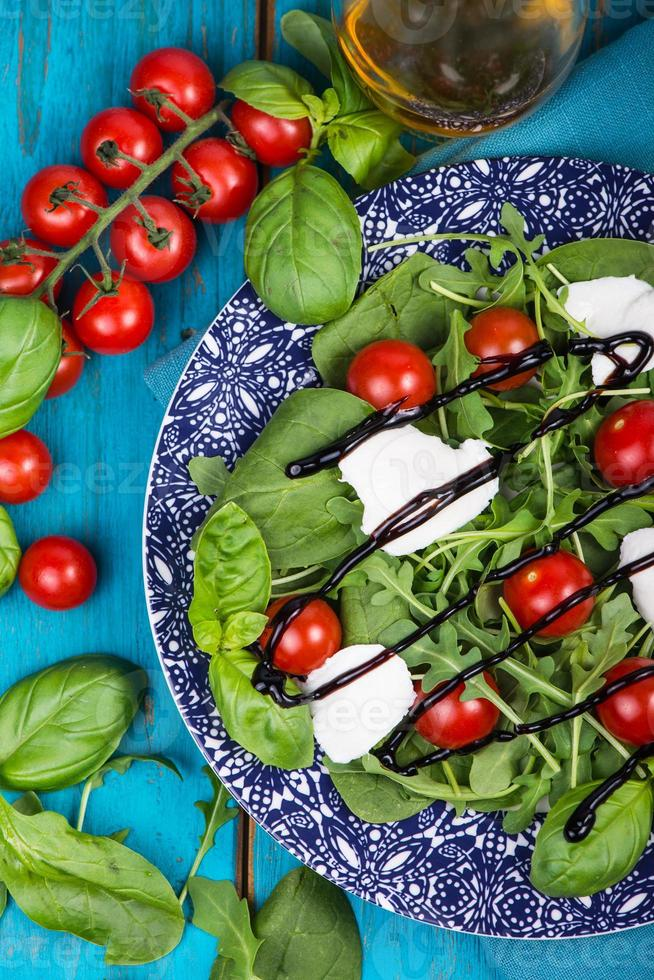 Healthy diet salad with tomatoes, mozzarella,basil and balsamic photo