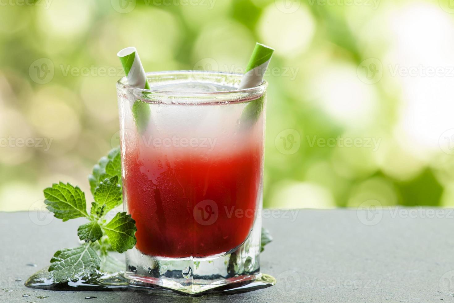 Frozen red cocktail with mint on the sun deck photo