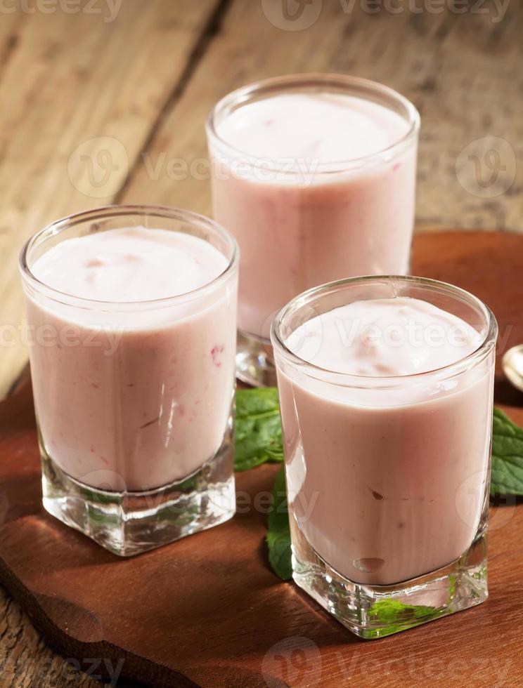 Fresh homemade yogurt berries in glasses, selective focus photo