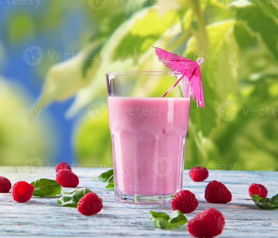Fresh fruits milk shake on wood photo