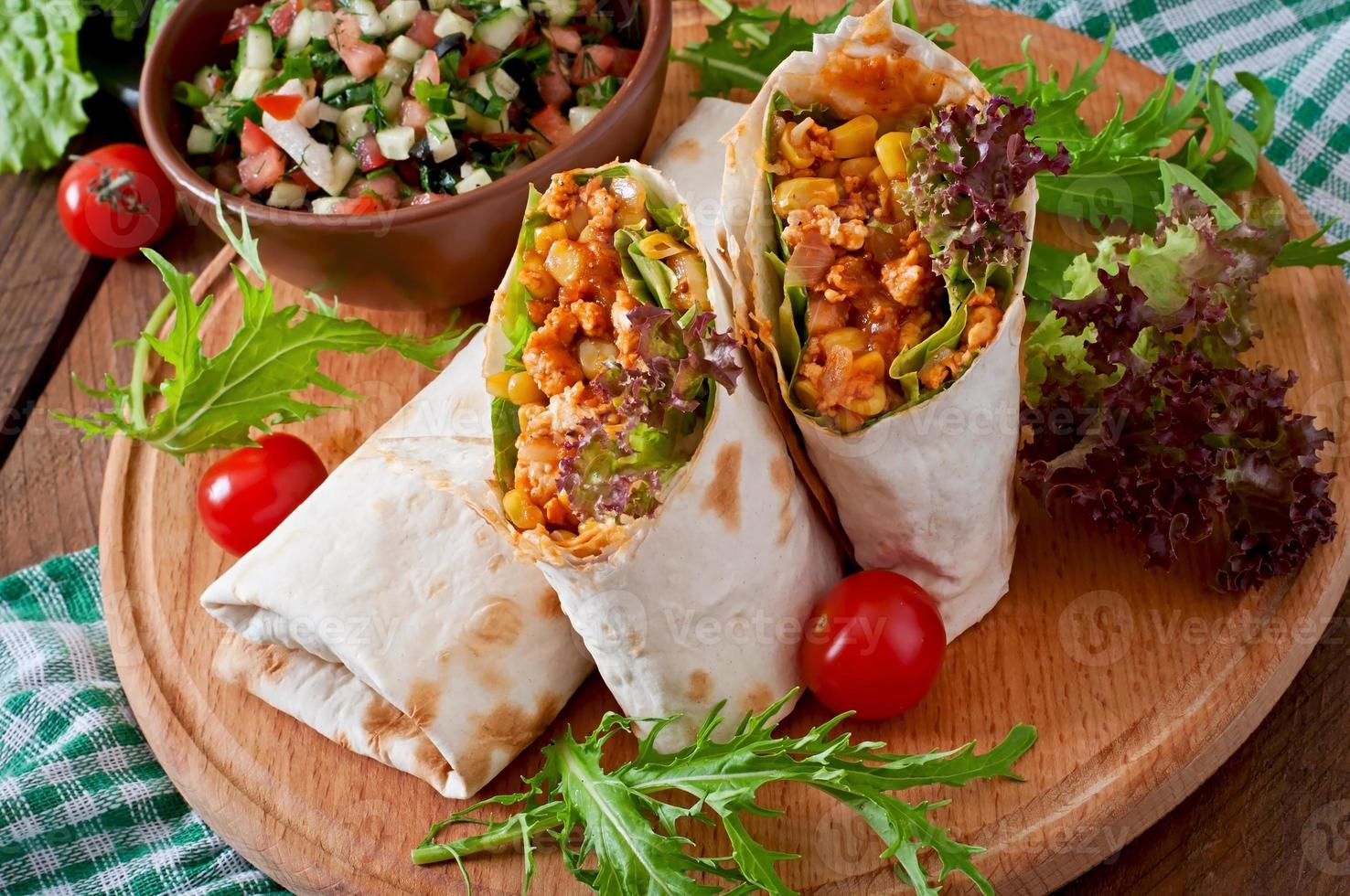 Burritos wraps with minced beef and vegetables photo