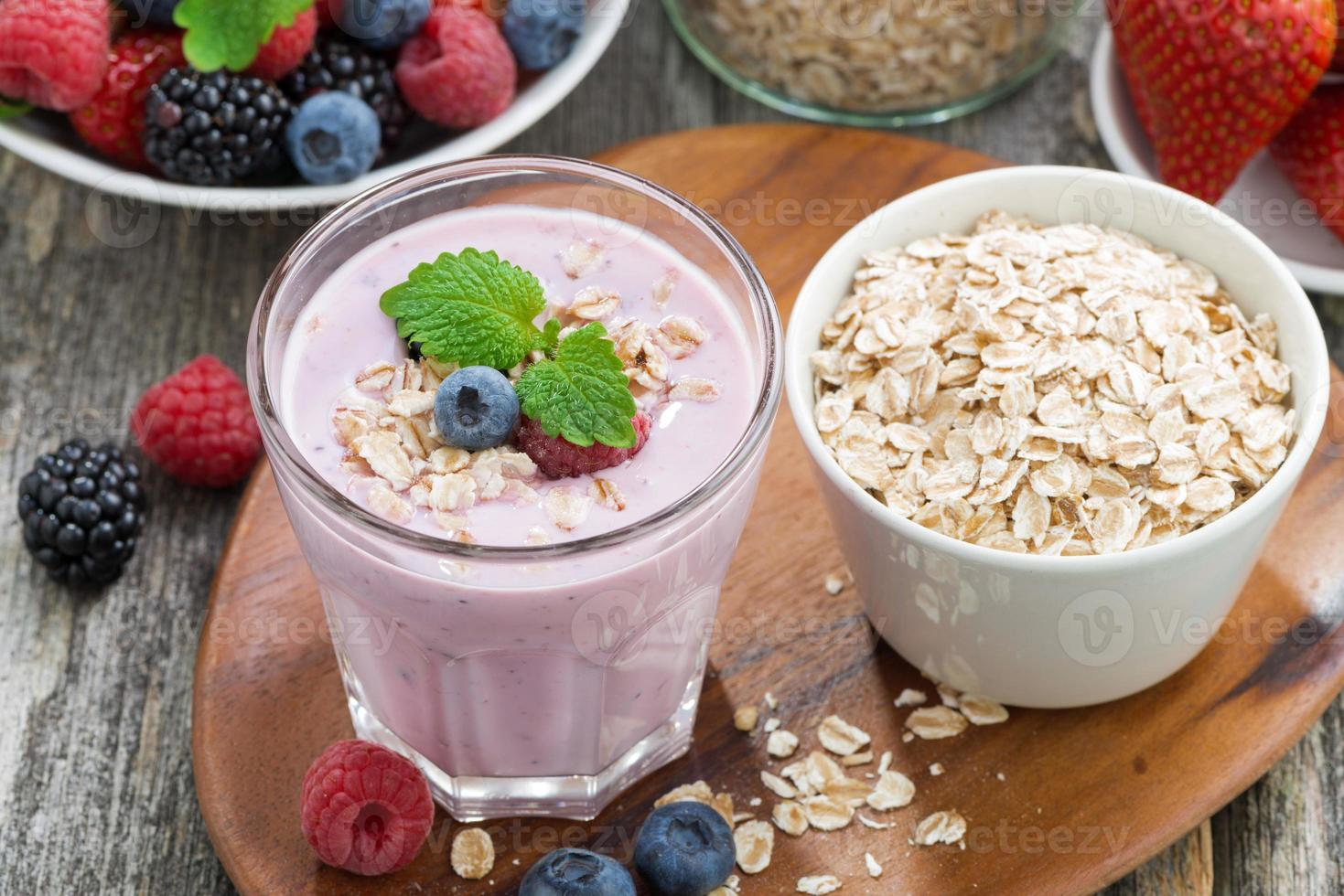 delicious berry smoothies with oatmeal, top view photo