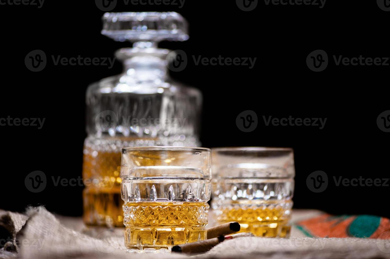 Whiskey and scotch drinks on wood with bar bottle photo