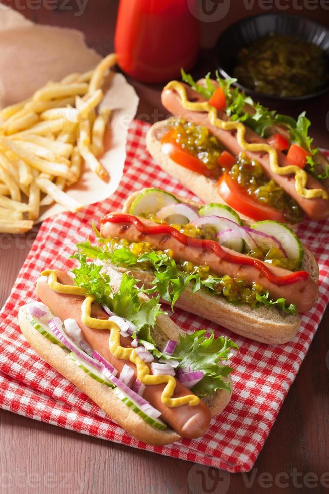 grilled hot dogs with vegetables ketchup mustard photo