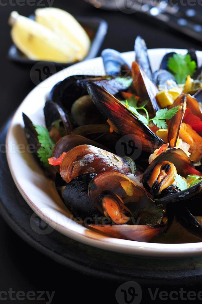 soup of wild mussels with white wine, vegetables, sage, coriander photo
