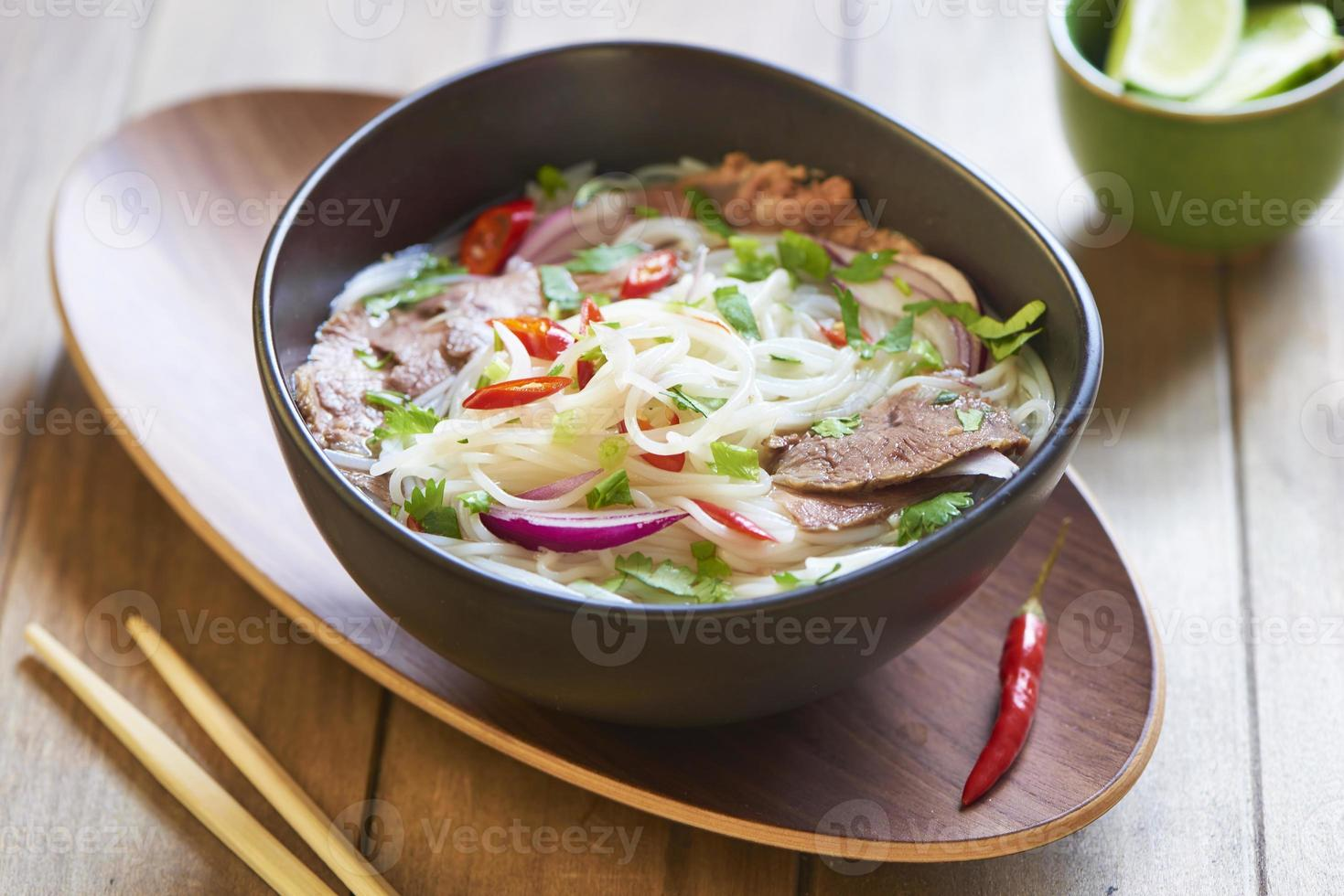 Rice noodle soup with sliced beef photo