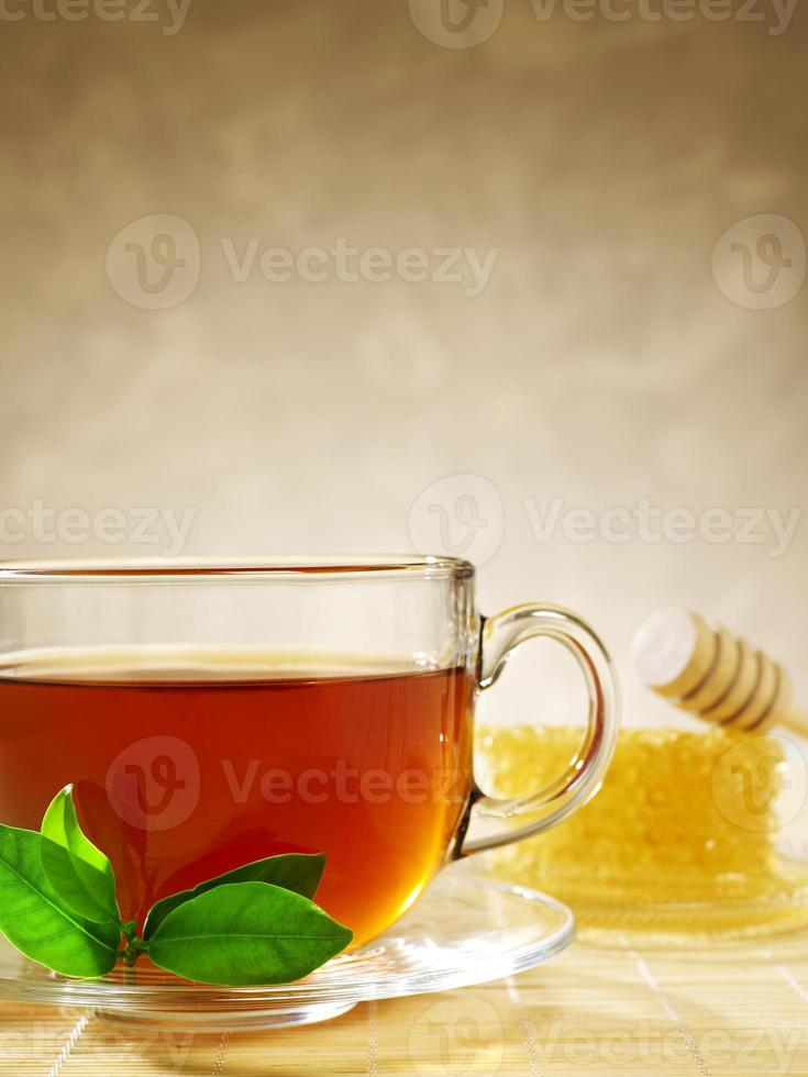 taza de té con miel foto