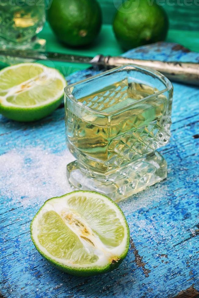 alcoholic cocktail with additions of lime photo