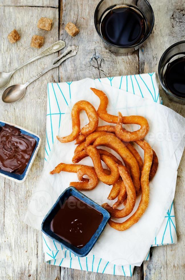 churros with chocolate sauce photo