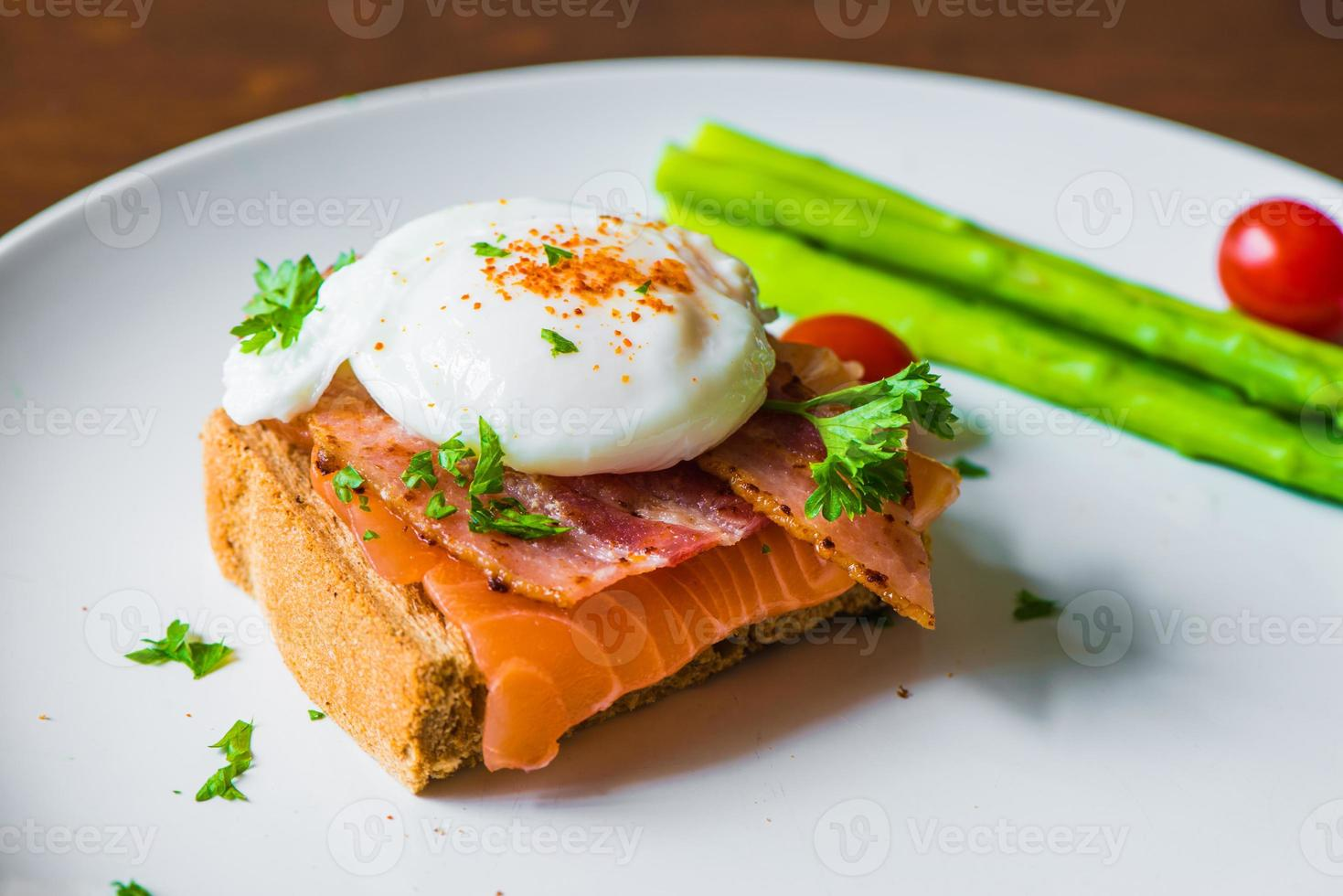 Sandwich with poached egg, parma ham and Salmon photo