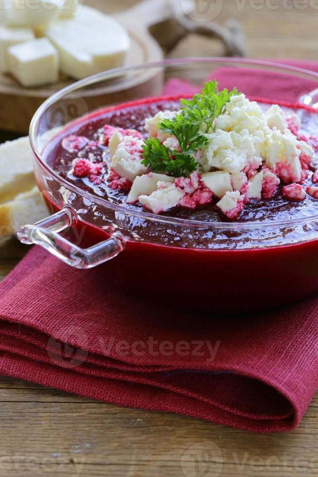 vegetable cream soup of beetroot with soft goat cheese photo