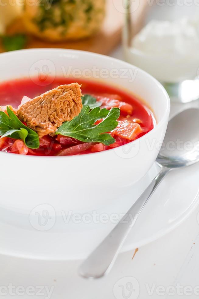 Ukrainian borsch with sour cream and pampushki photo
