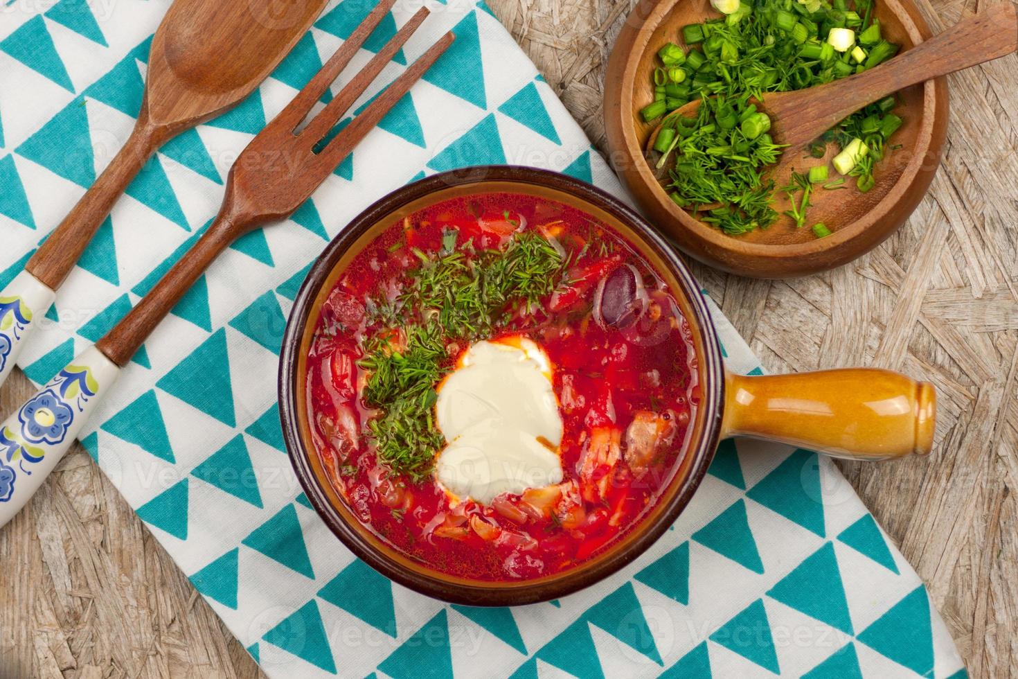 Bowl of red beetroot soup photo
