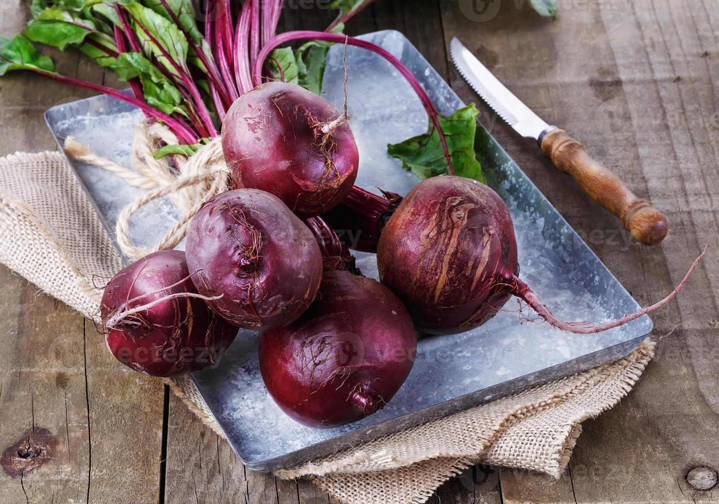 Organic beetroot over rustic wooden background photo