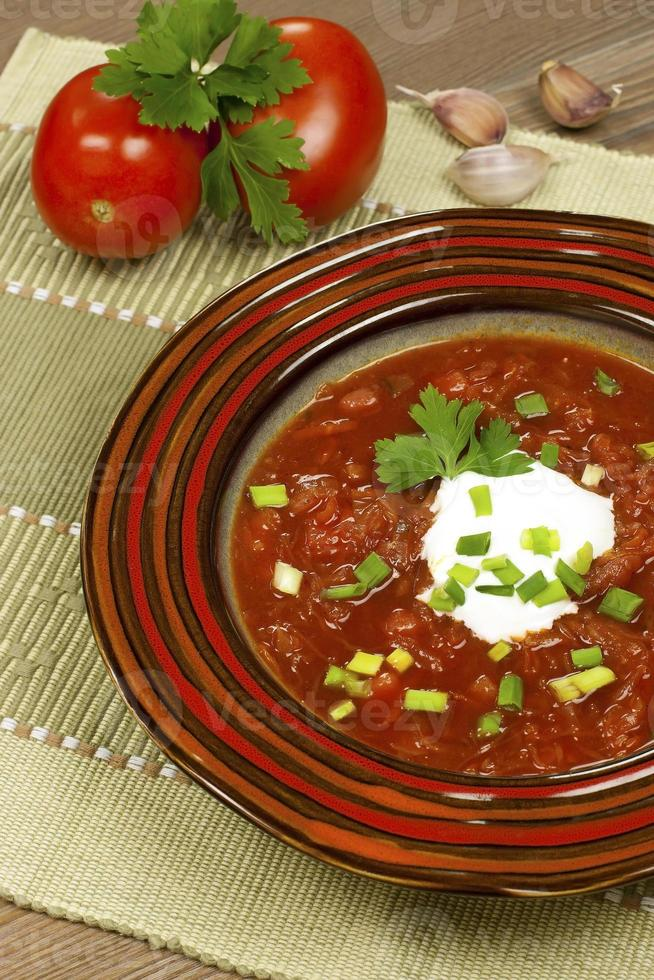 Beetroot  soup with garlic and sour cream photo