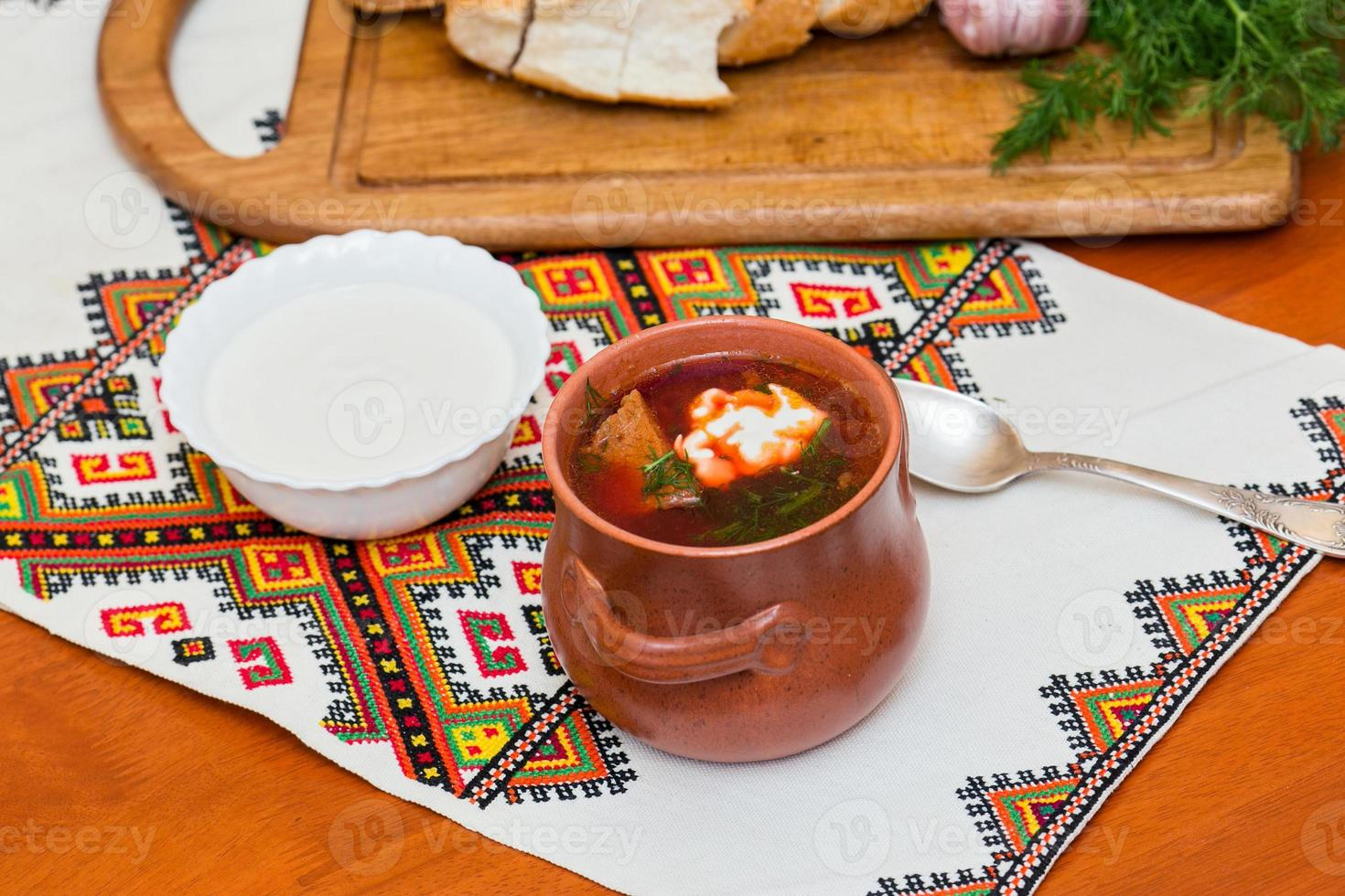 Ukrainian borsch and a bowl of sour cream photo