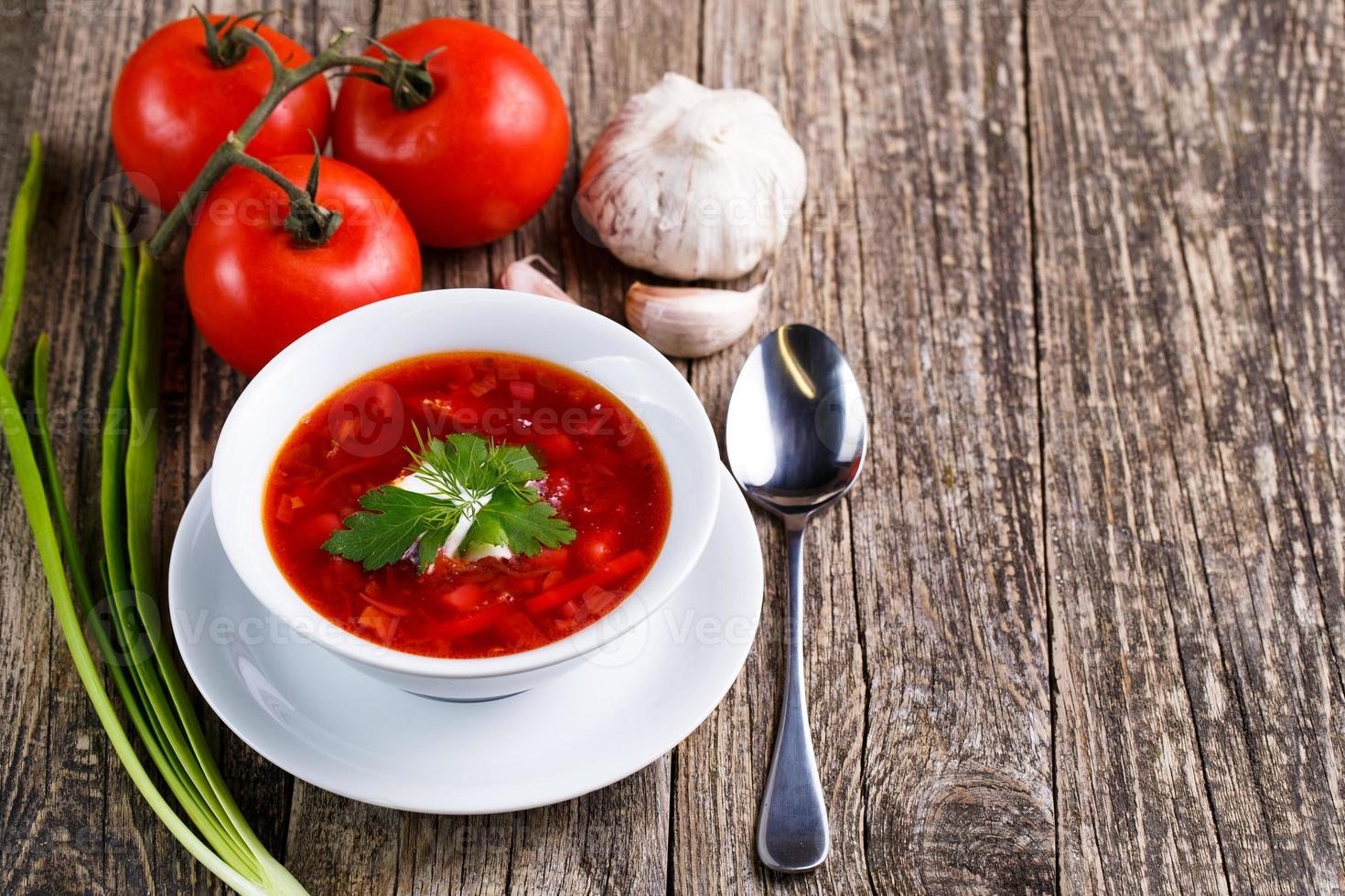 Borsch with bread on a wooden background. photo