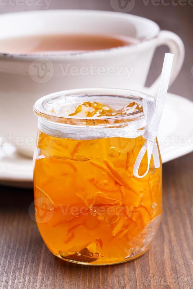 Orange jam and cup of tea photo