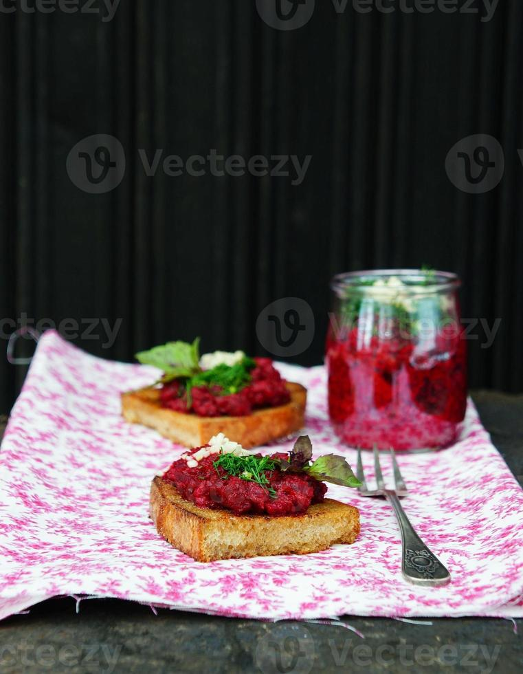 beetroot appetizer with garlic and olive oil on rye-bread photo