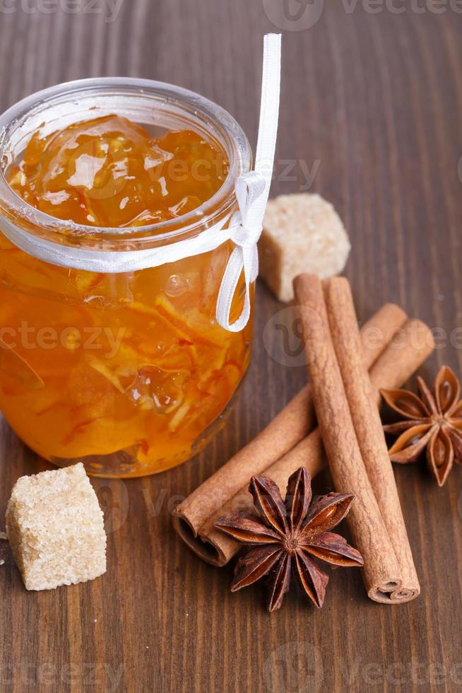 Orange jam with cinnamon, star anise and brown shugar photo