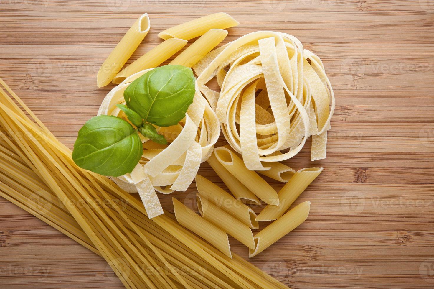 different kinds of pasta (spaghetti, fusilli, penne, linguine) photo