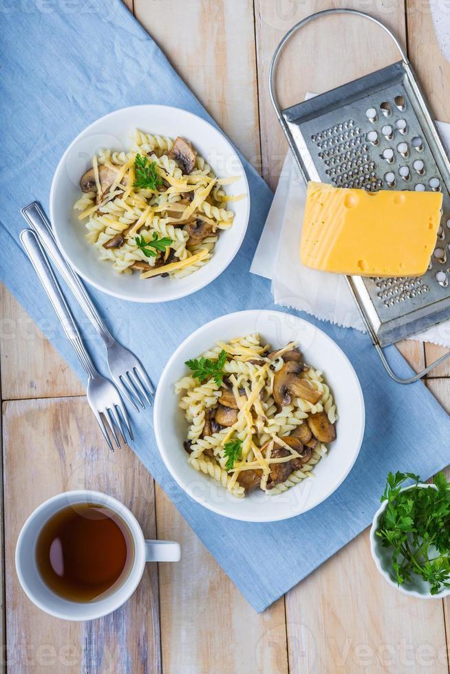 Pasta with mushrooms, cheese and fresh parsley photo