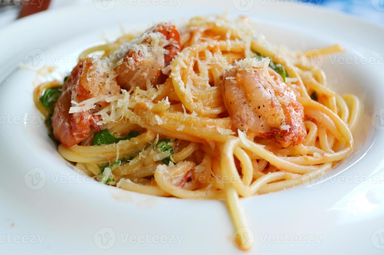 Delicious pasta spaghetti with shrimps and other seafood photo