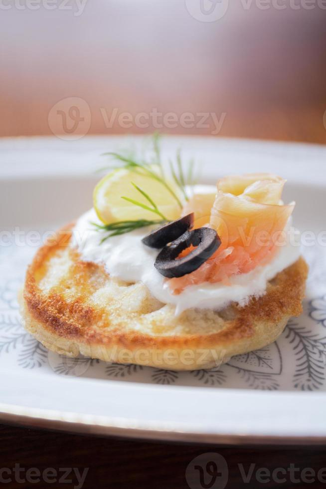 Toasted baguette with salmon photo