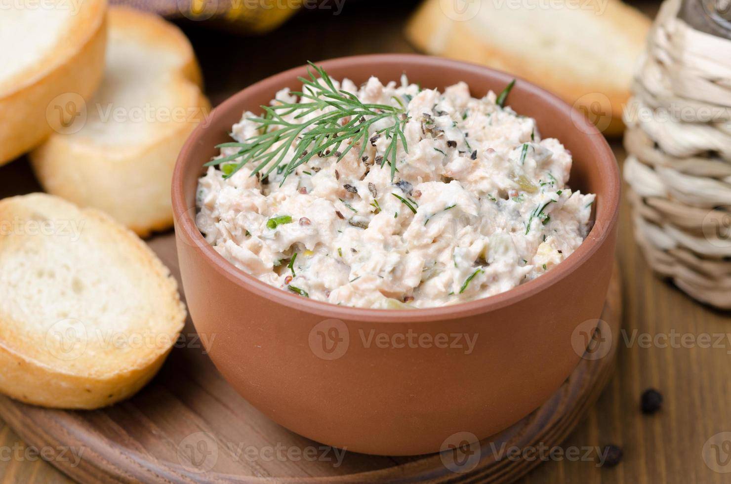 pate of smoked fish with sour cream and herbs, close-up photo