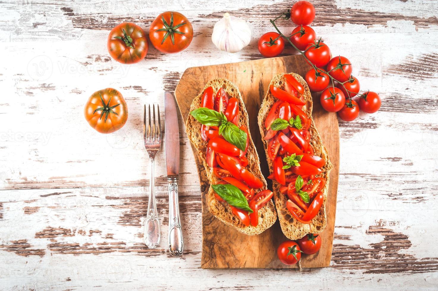 Italian starter, bruschetta with Sicilian red fresh tomato on a photo