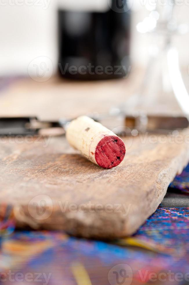 wine cork with an open bottle in the background. photo