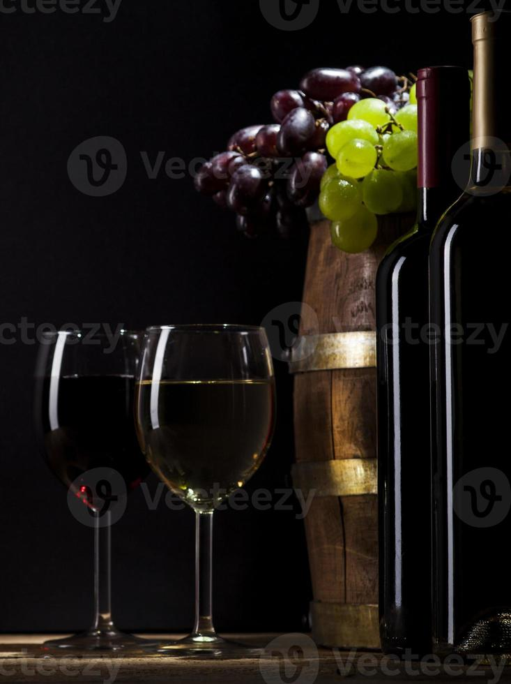 Red and white wine on wooden background photo
