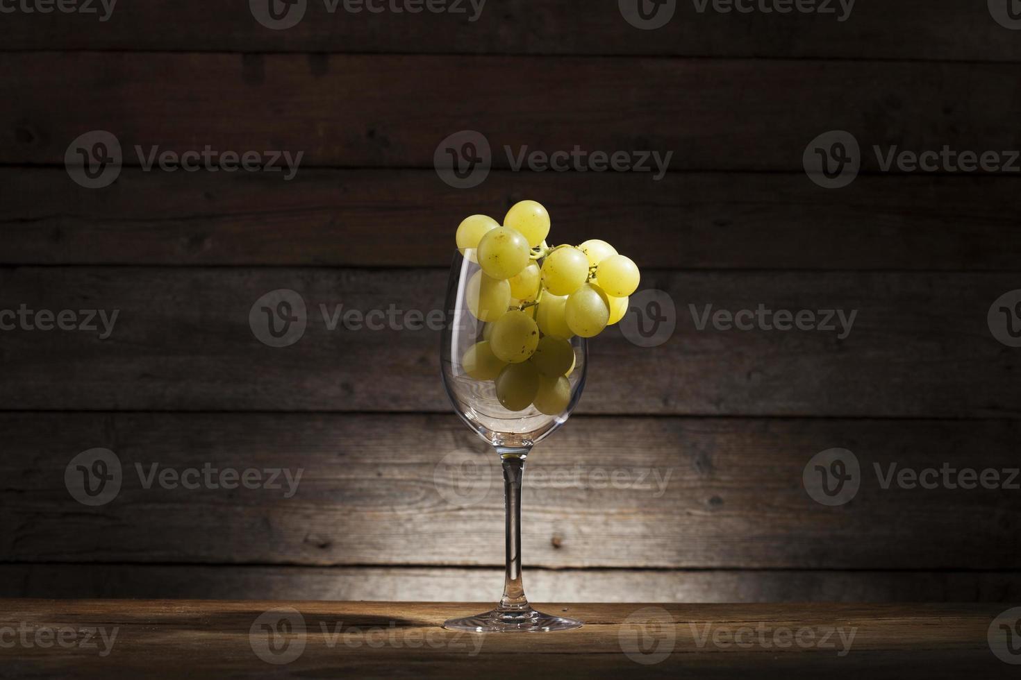 Glass and grape photo