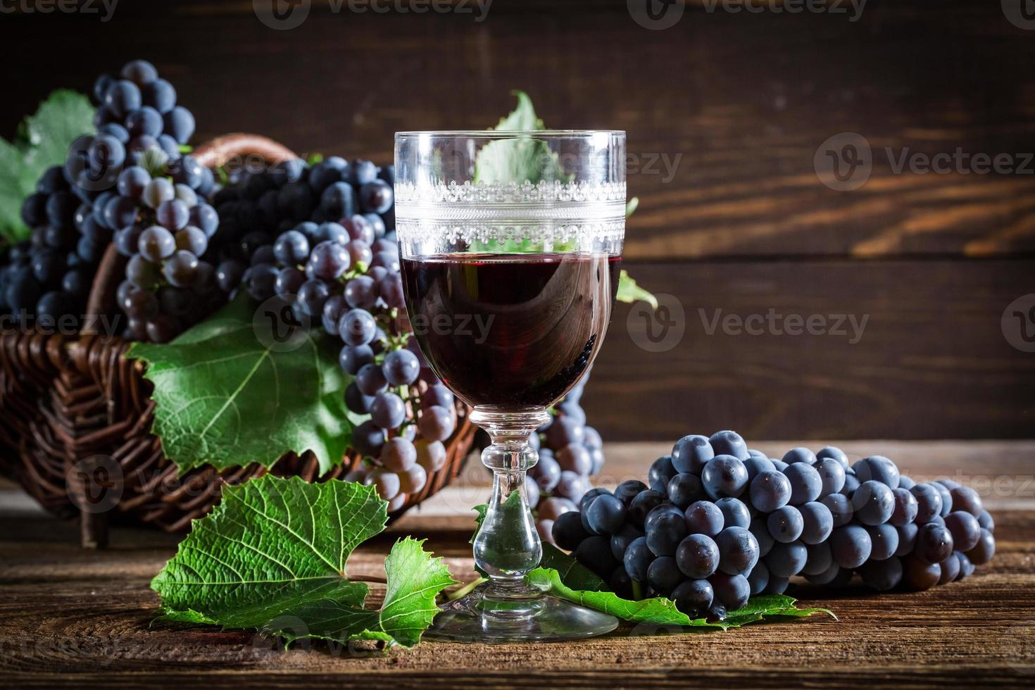 Tasty red wine with grapes photo