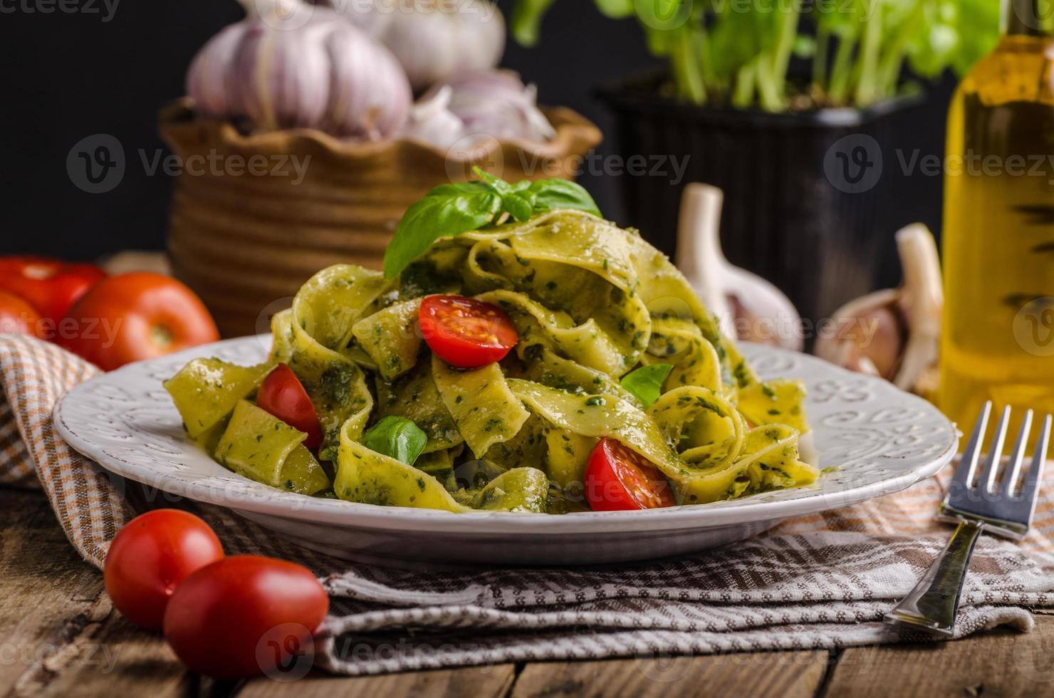 Pasta with basil pesto photo