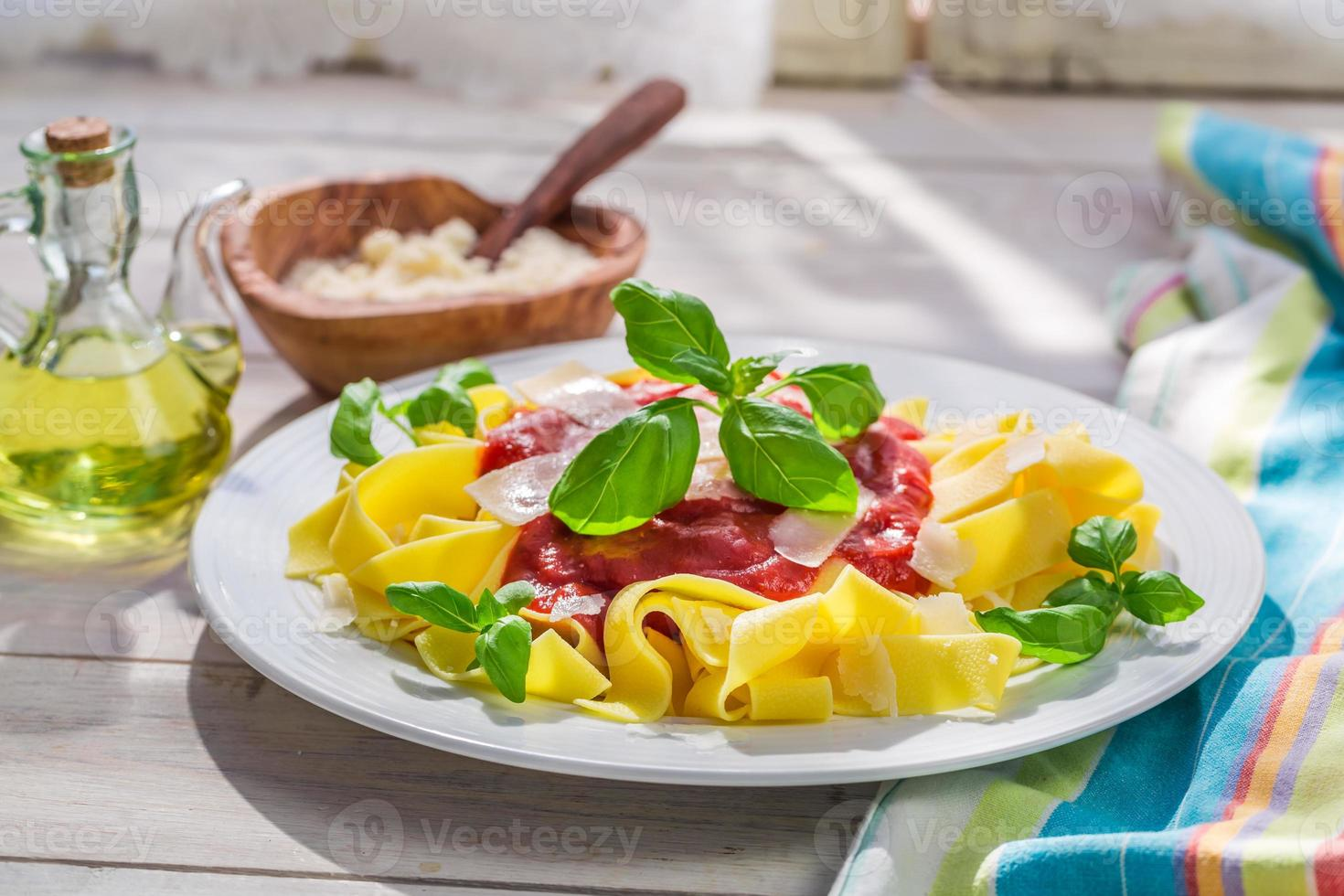 Homemade pappardelle pasta with tomato, basil and parmesan photo
