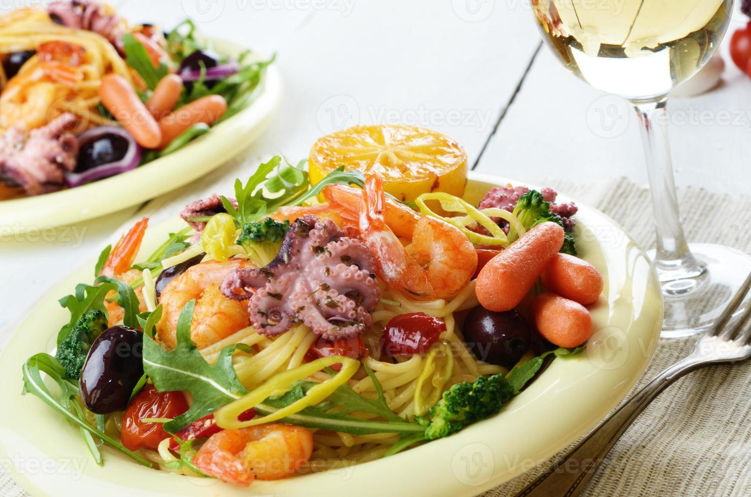 Seafood spaghetti pasta dish with octopus and shrimps photo