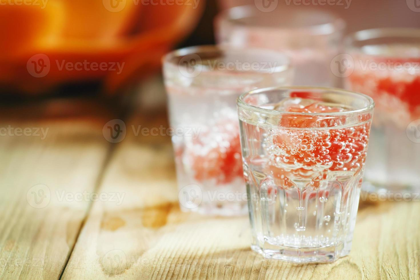 Soda with pink grapefruit in glasses photo