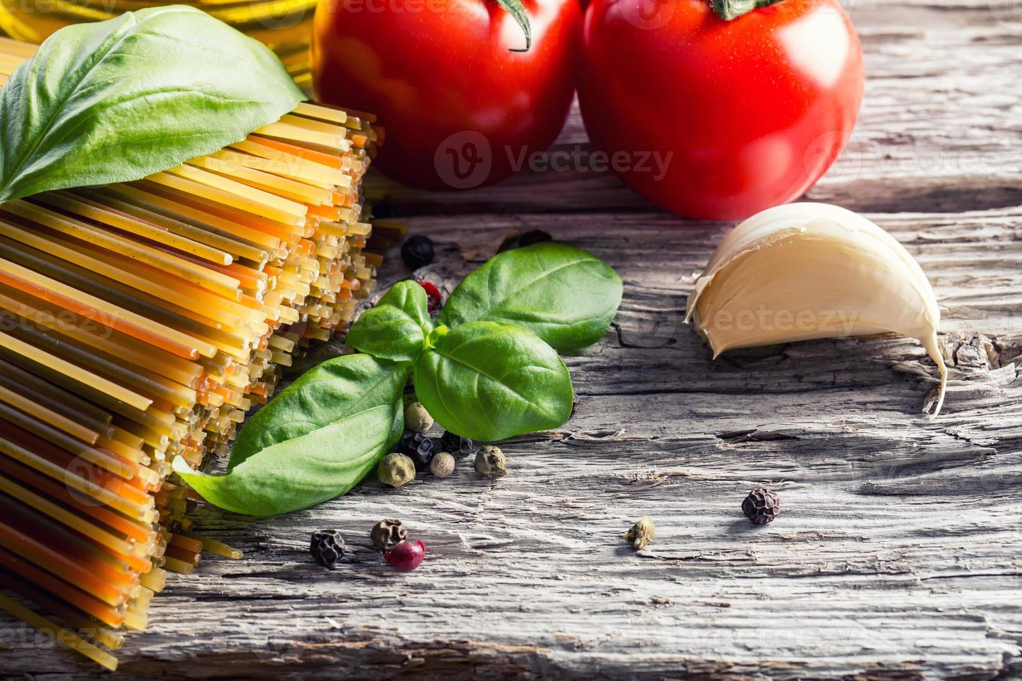 Italian and Mediterranean food ingredients on old wooden background. photo
