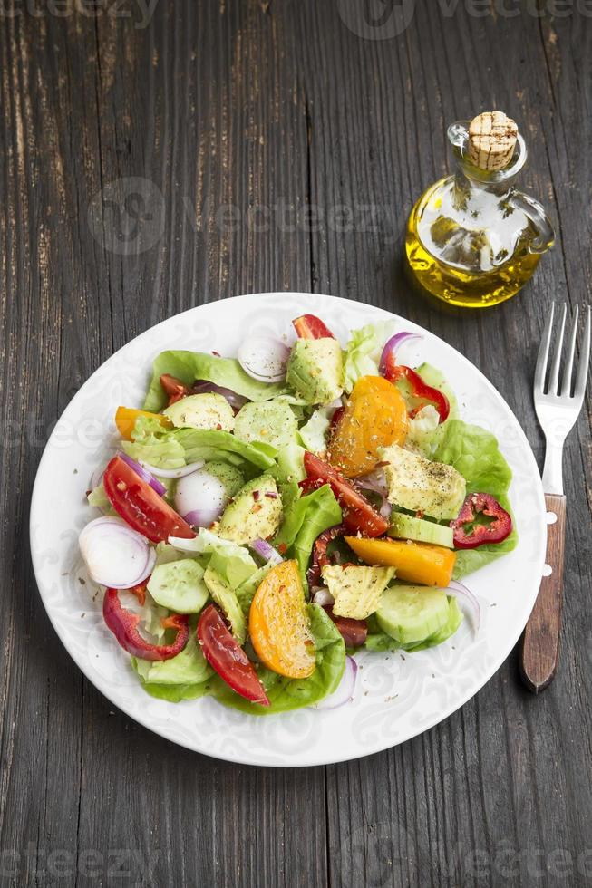Fresh Salad Meal with Tomatoes,Lettuce,Peppers, Onion and Avocad photo