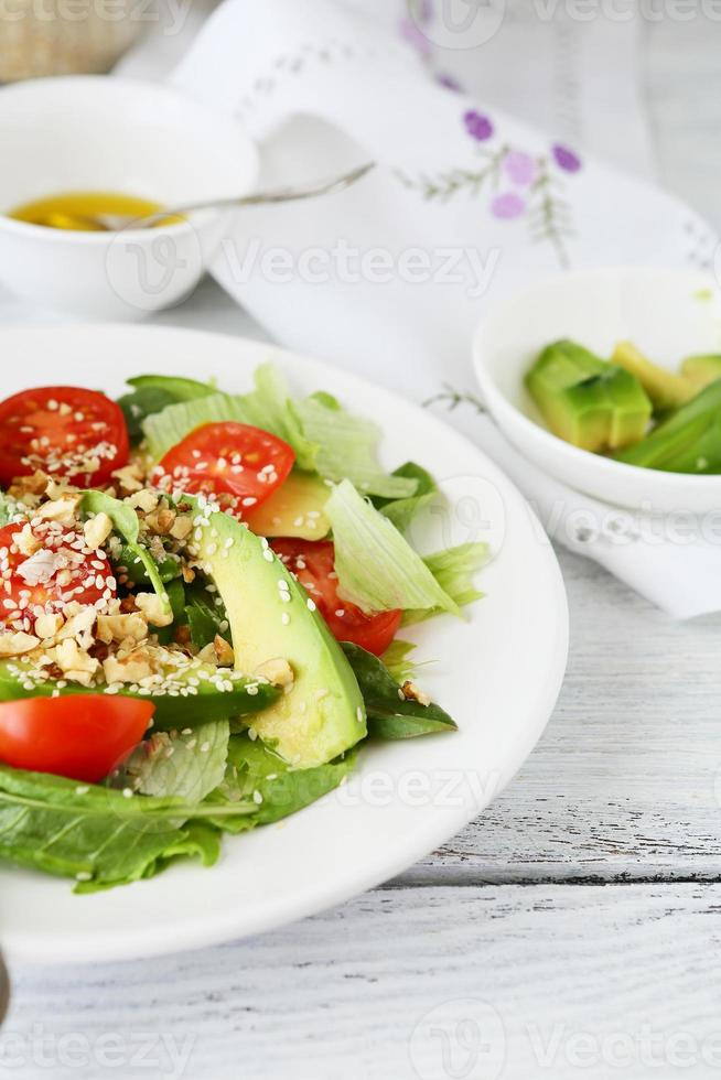 Fresh salad with avocado photo