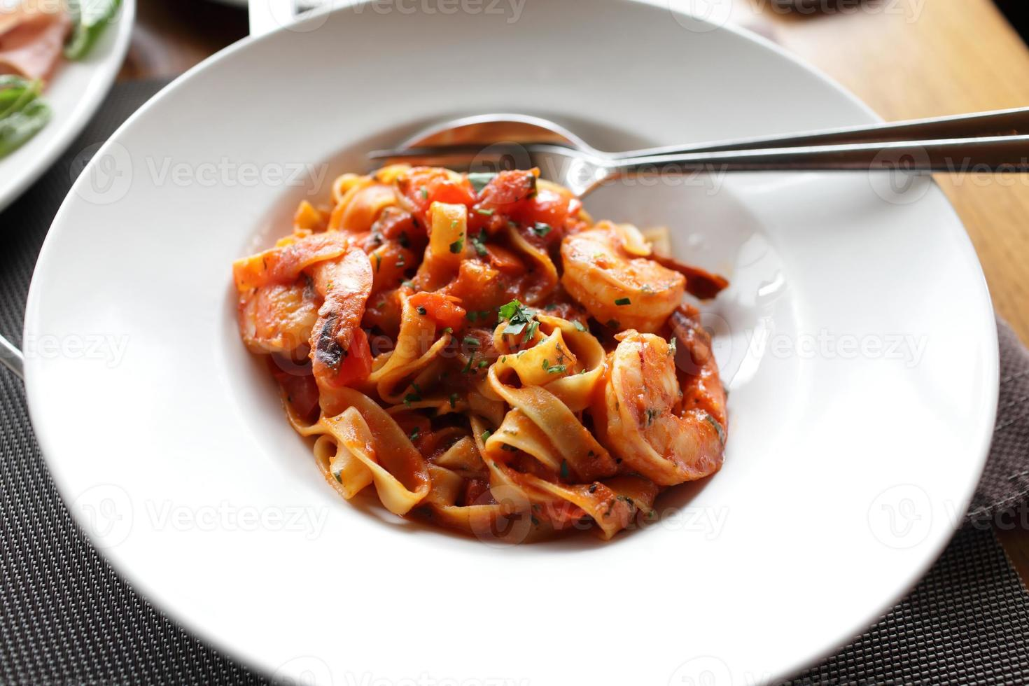 Fettuccine with shrimp and tomatoes photo