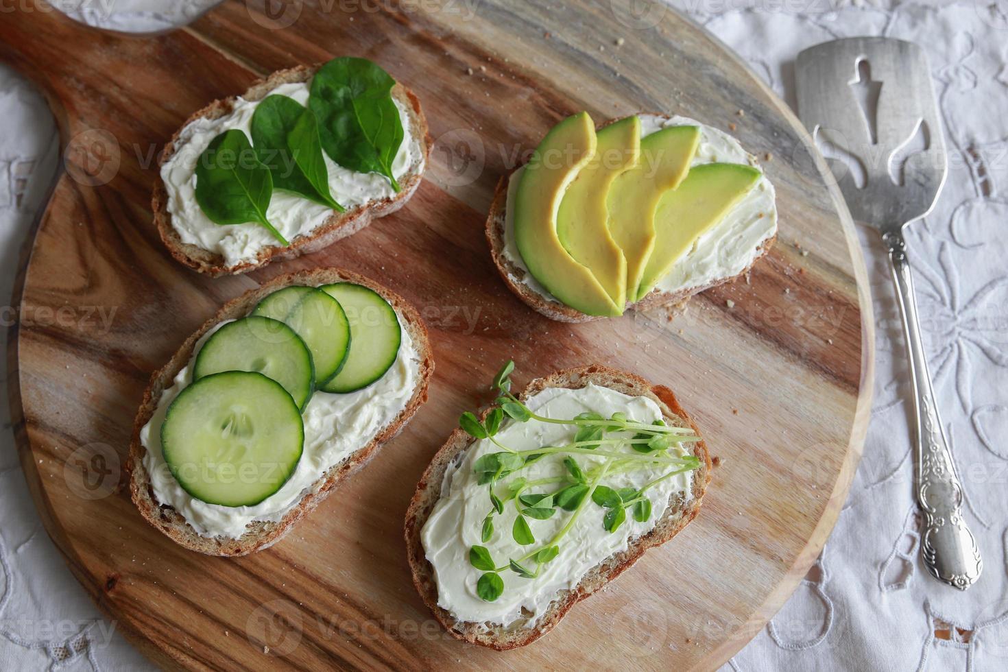 Green sourdough open face sandwiches photo
