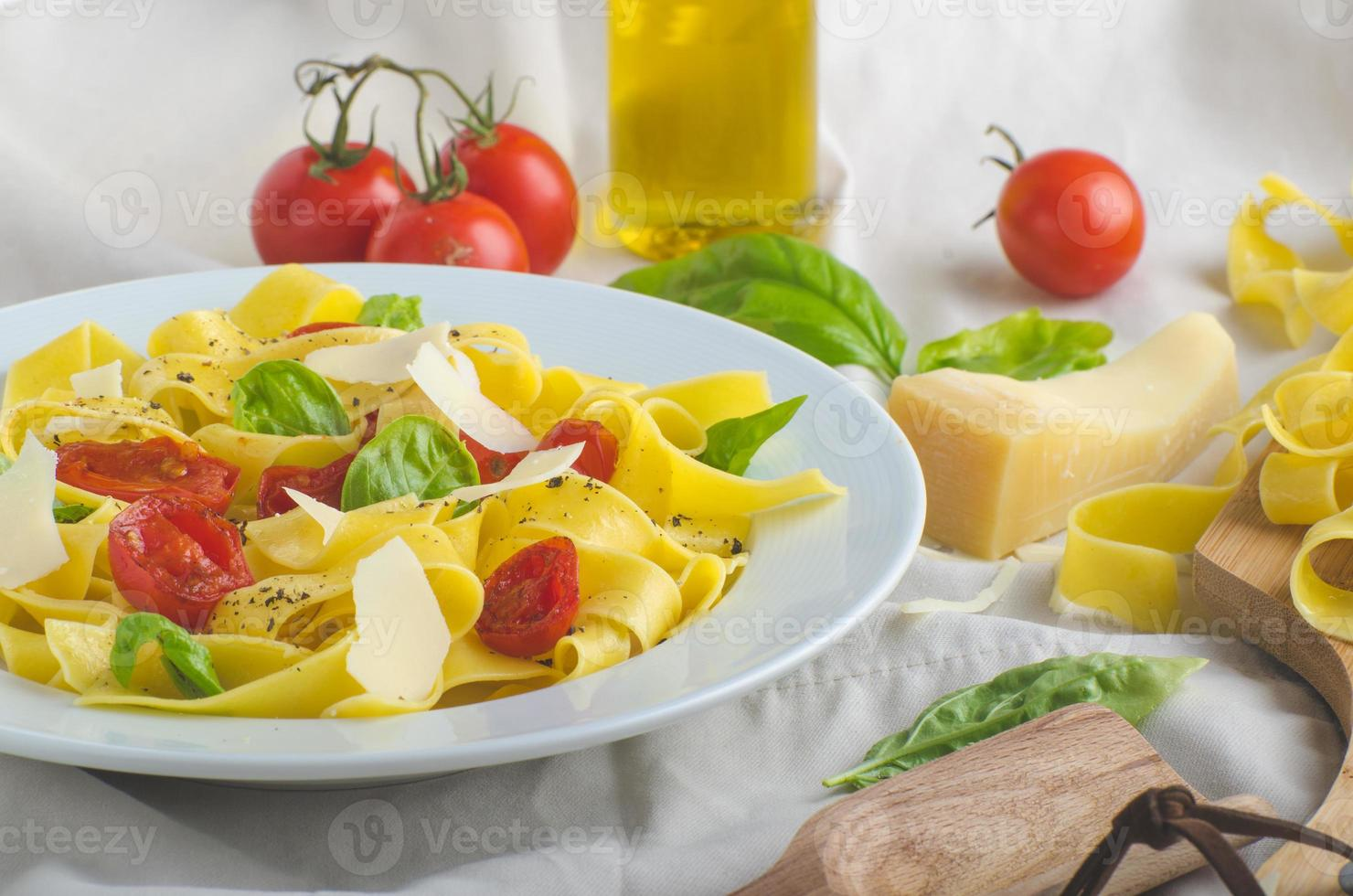 Tagliatelle in Italian colors, roasted tomatoes, basil Tagliatelle photo