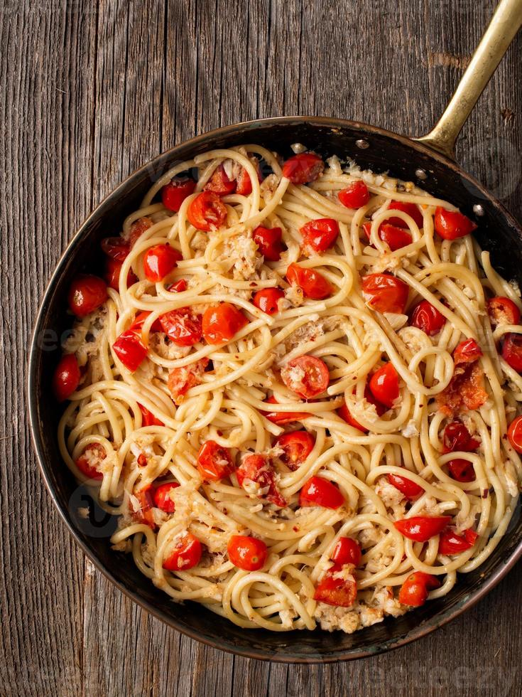 rustic spicy italian crab and cherry tomato spaghetti pasta photo