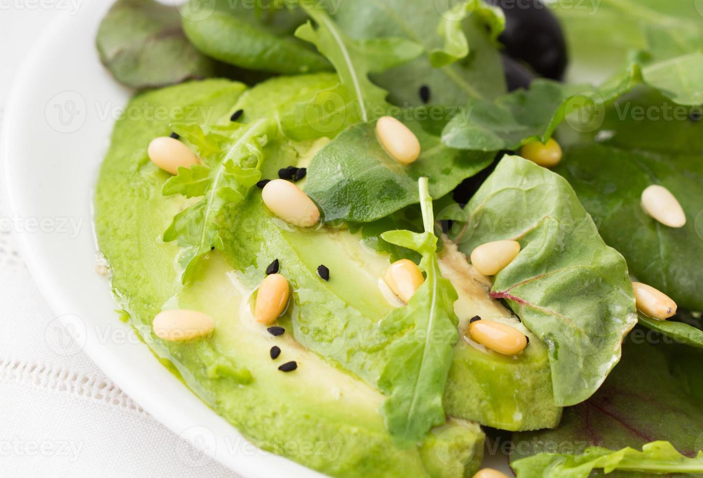 Salad with avocado and arugula photo