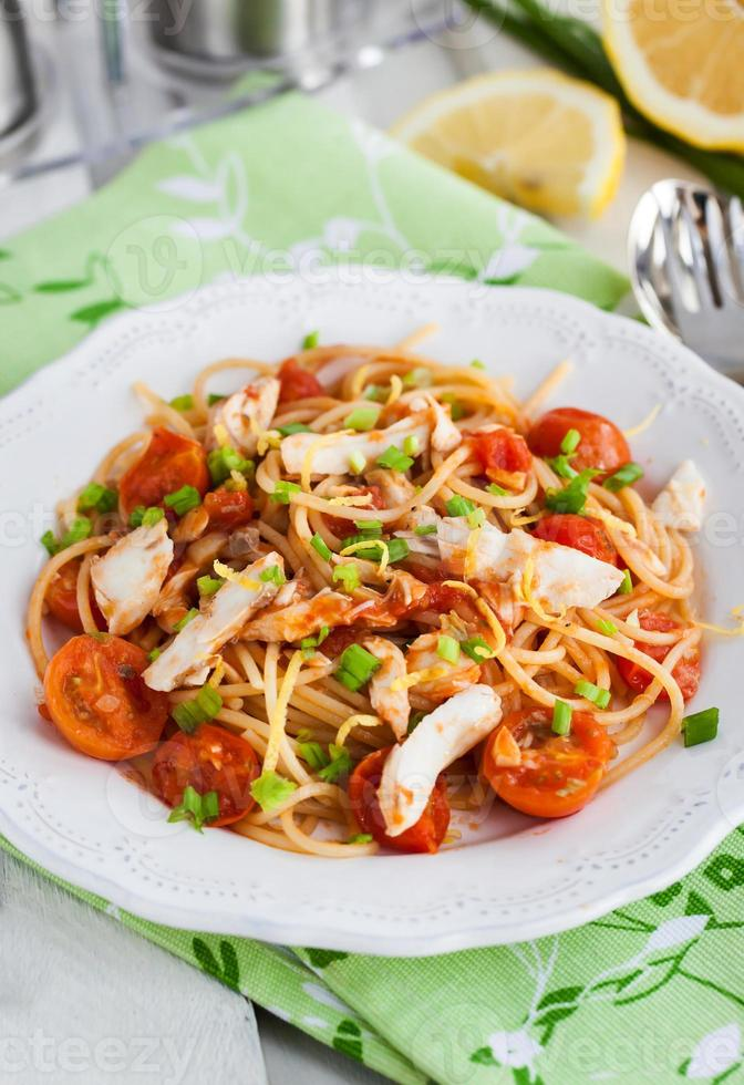 Fresh delicious pasta with fish and tomato sauce photo